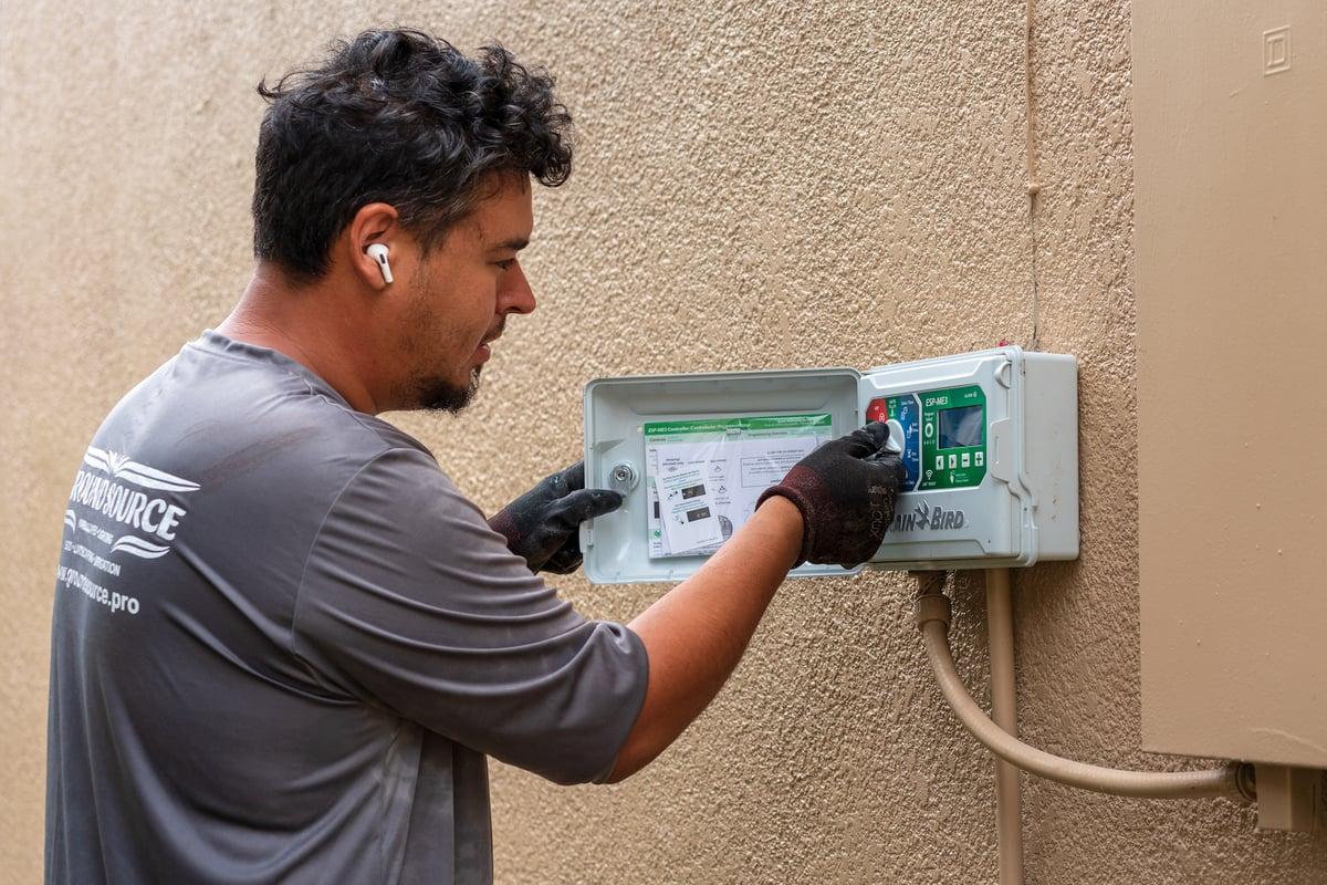 irrigation technician adjust smart sprinkler system