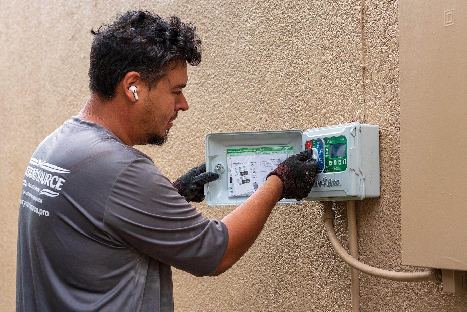Irrigation team installing a controller