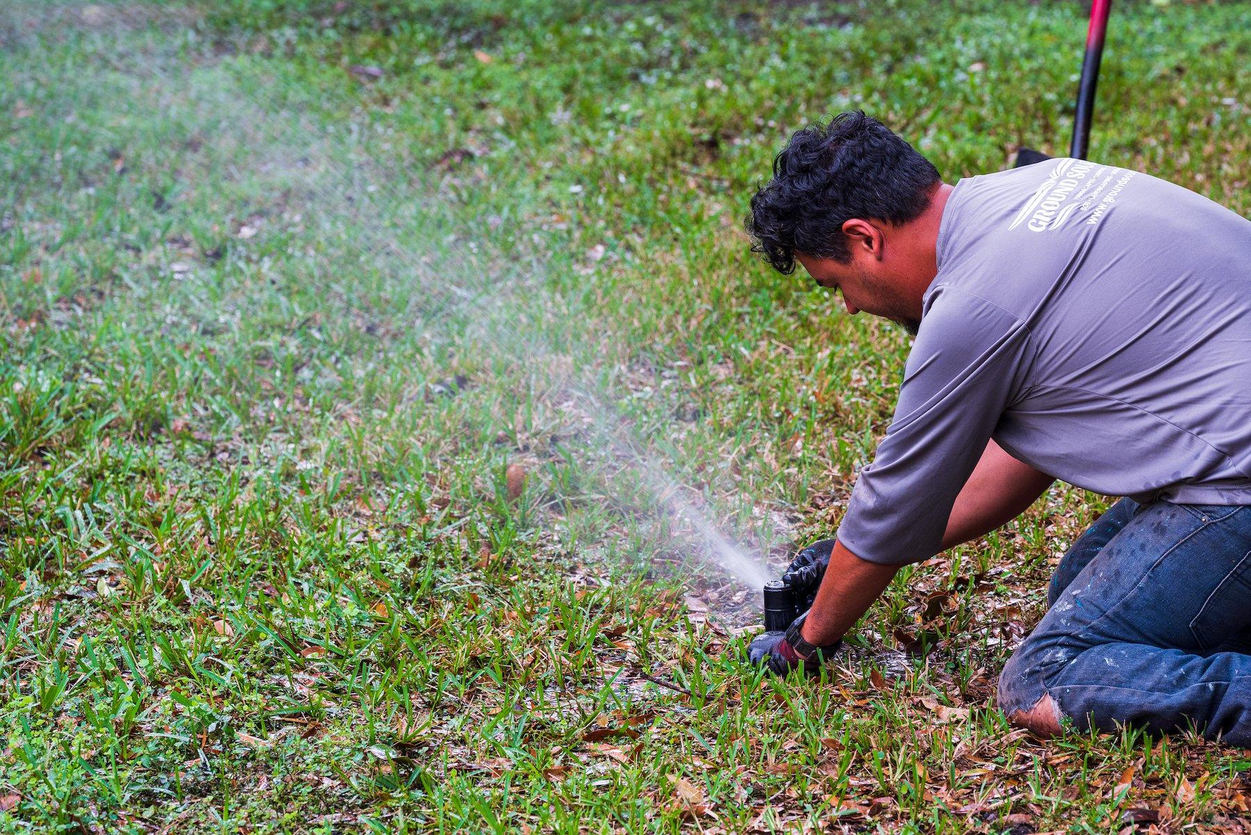 Irrigation crew making sprinkler adjustments