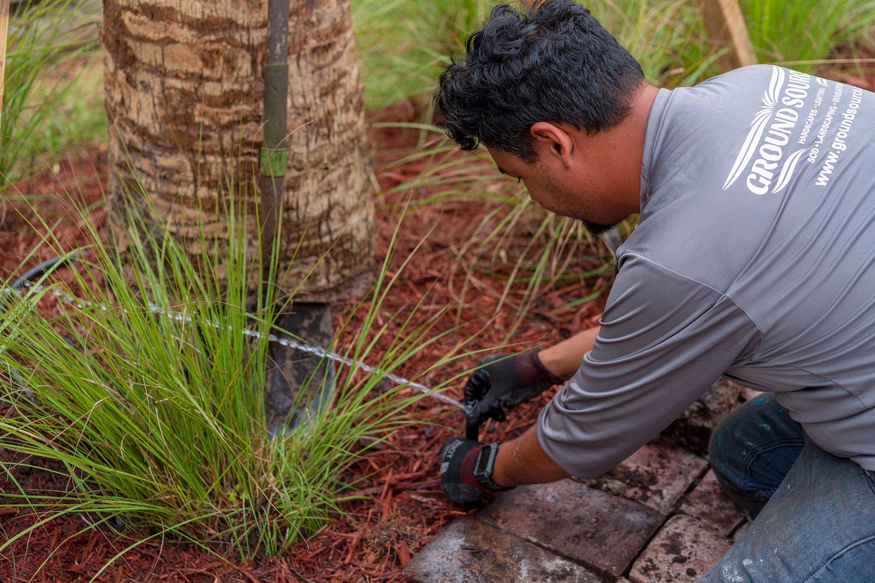irrigation crew installing sprinkler system