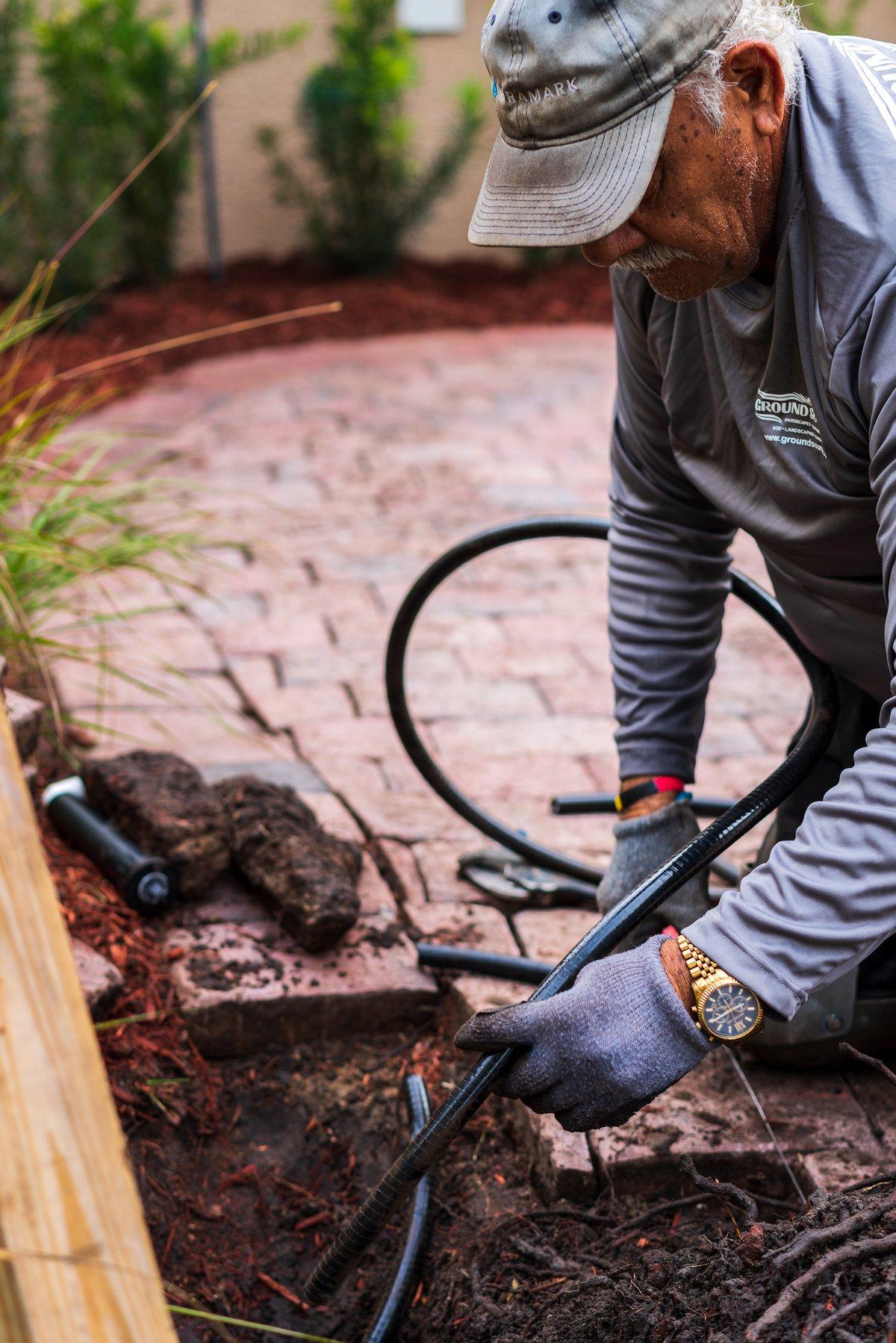 irrigation installation near paver patio
