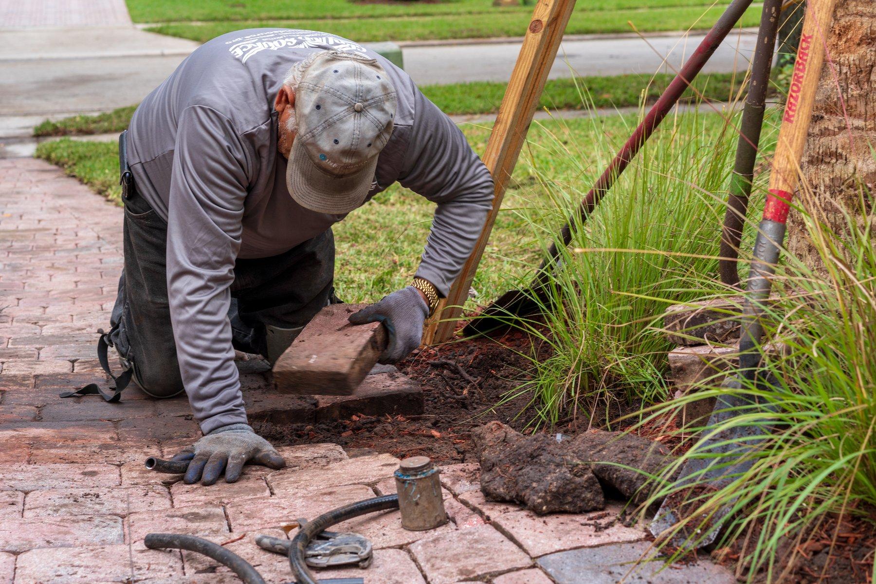 Irrigation team repairing sprinkler heads