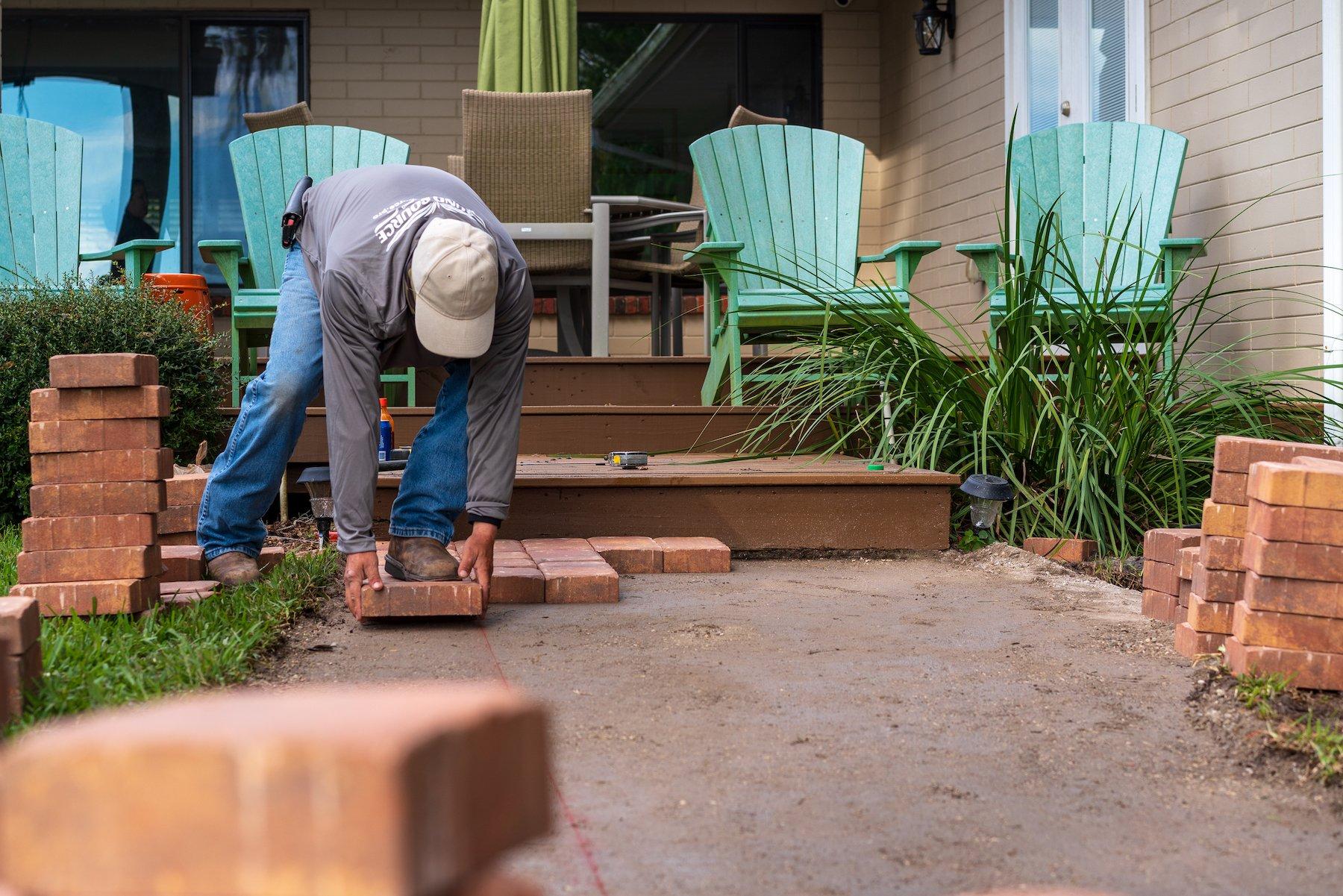 Hardscaping installation crew installing pavers