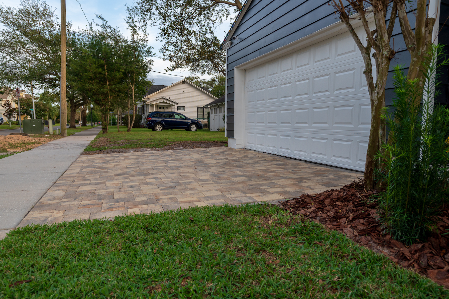 Sloping driveway away from the house