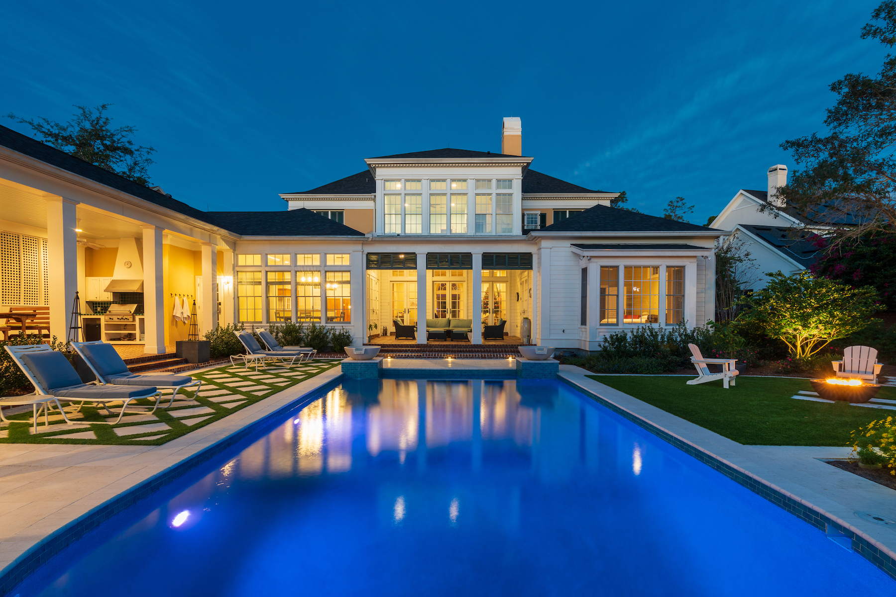 Serene backyard with artificial turf, pool and patio