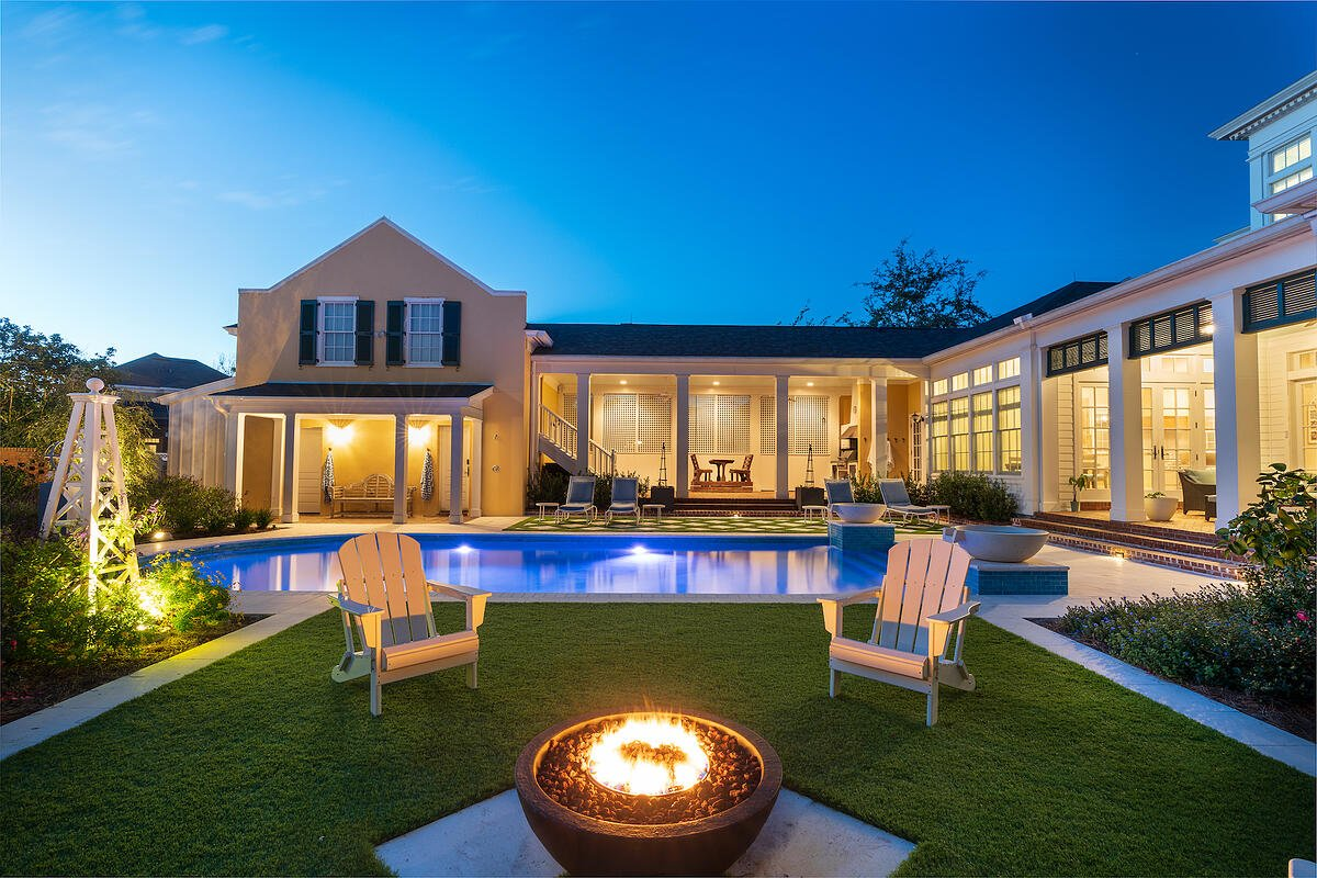 artificial turf around pool with firepit and seating