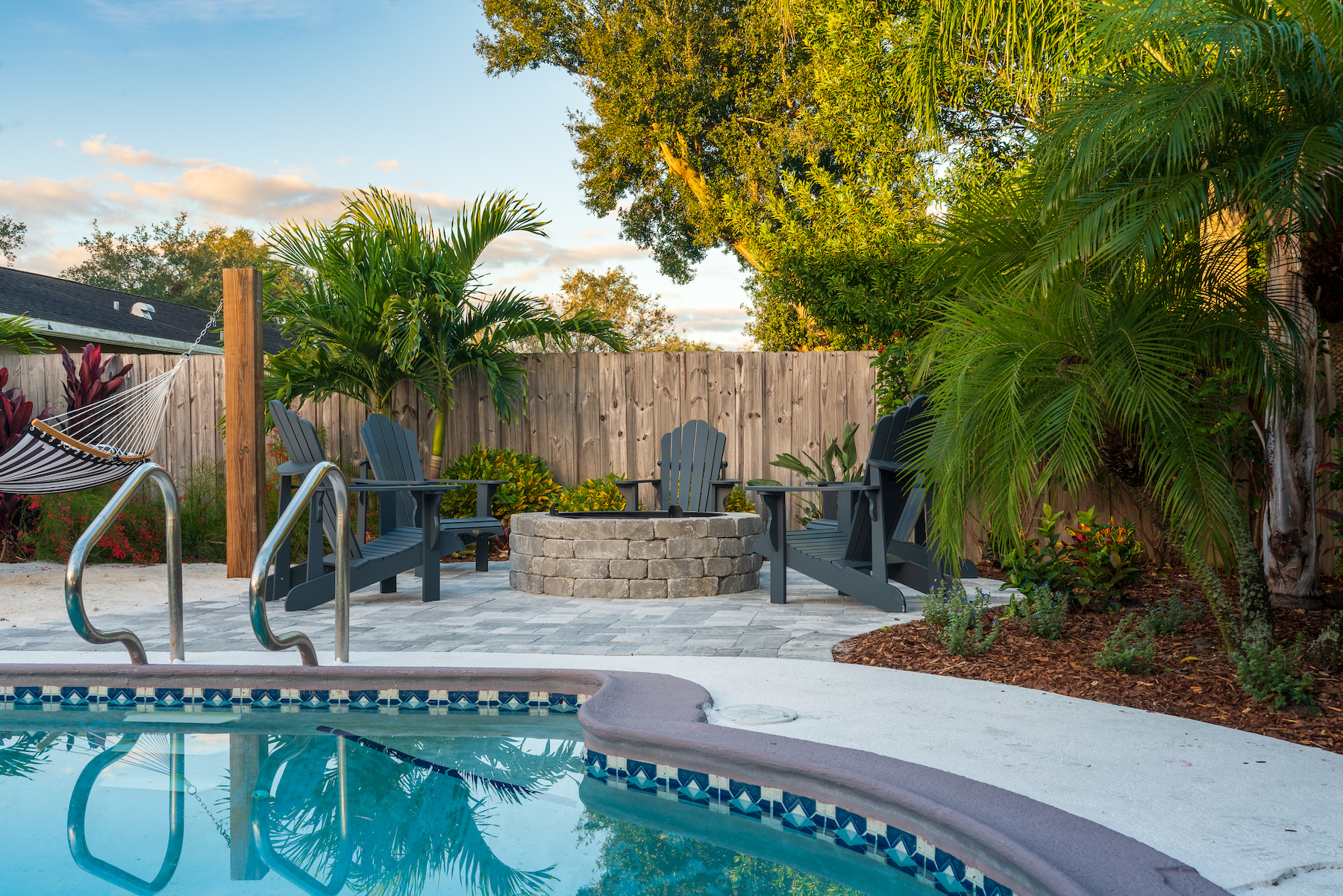 Petite palms for pool landscape installation