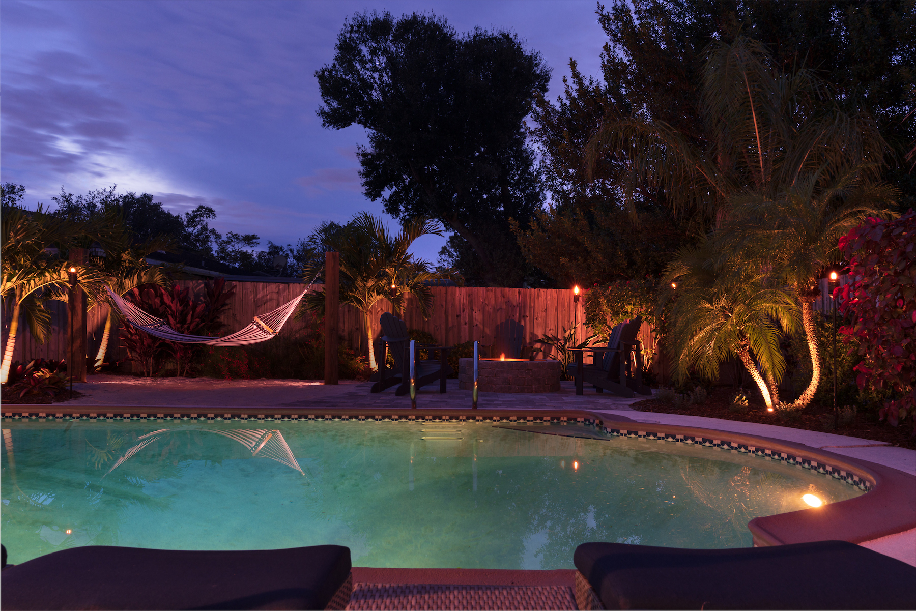 Pool patio with firepit and beach area