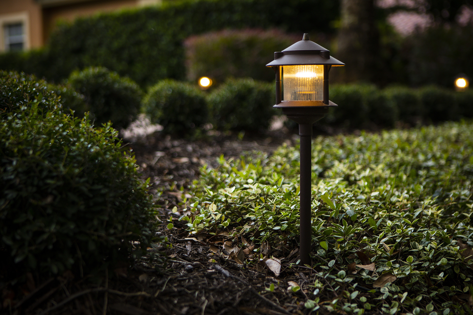 landscape lighting fixture with a cap to direct light down