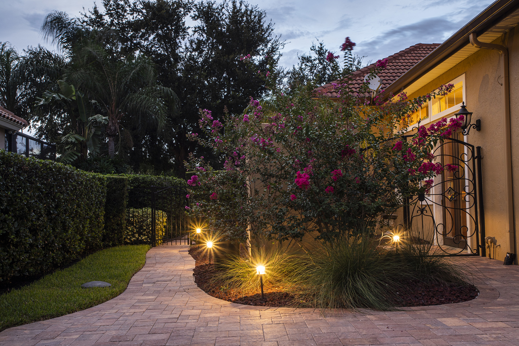 landscape lighting, lighting a walkway from the driveway to the house