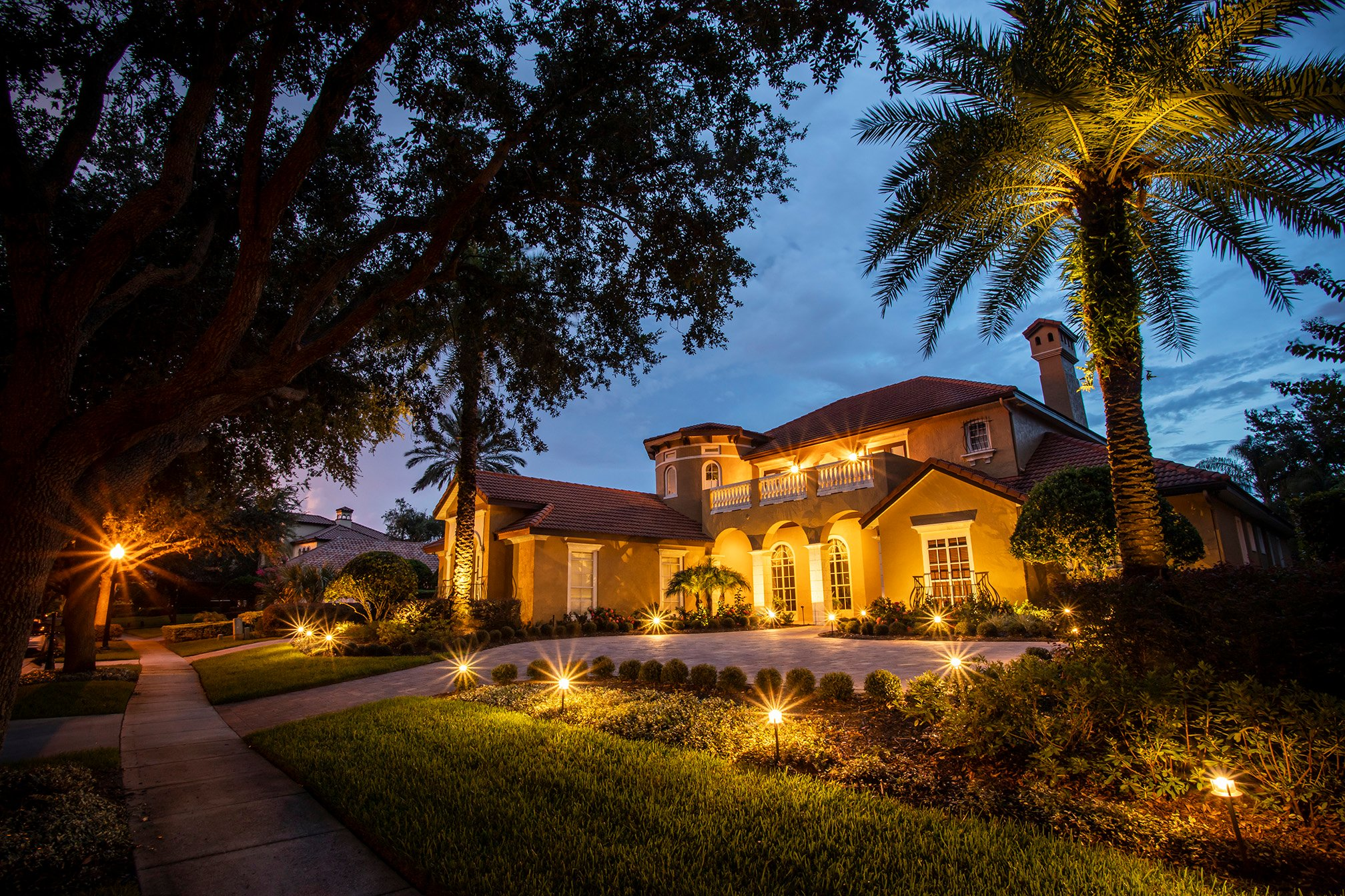 house with professional landscape lighting near Orlando, FL