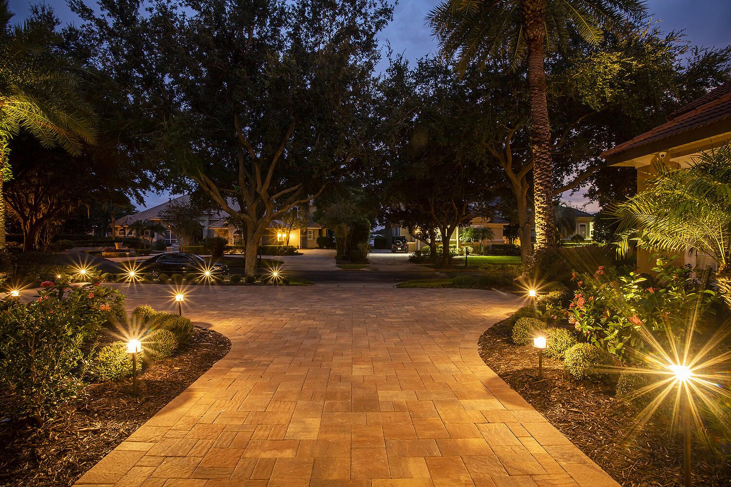Paver driveway with landscape lighting