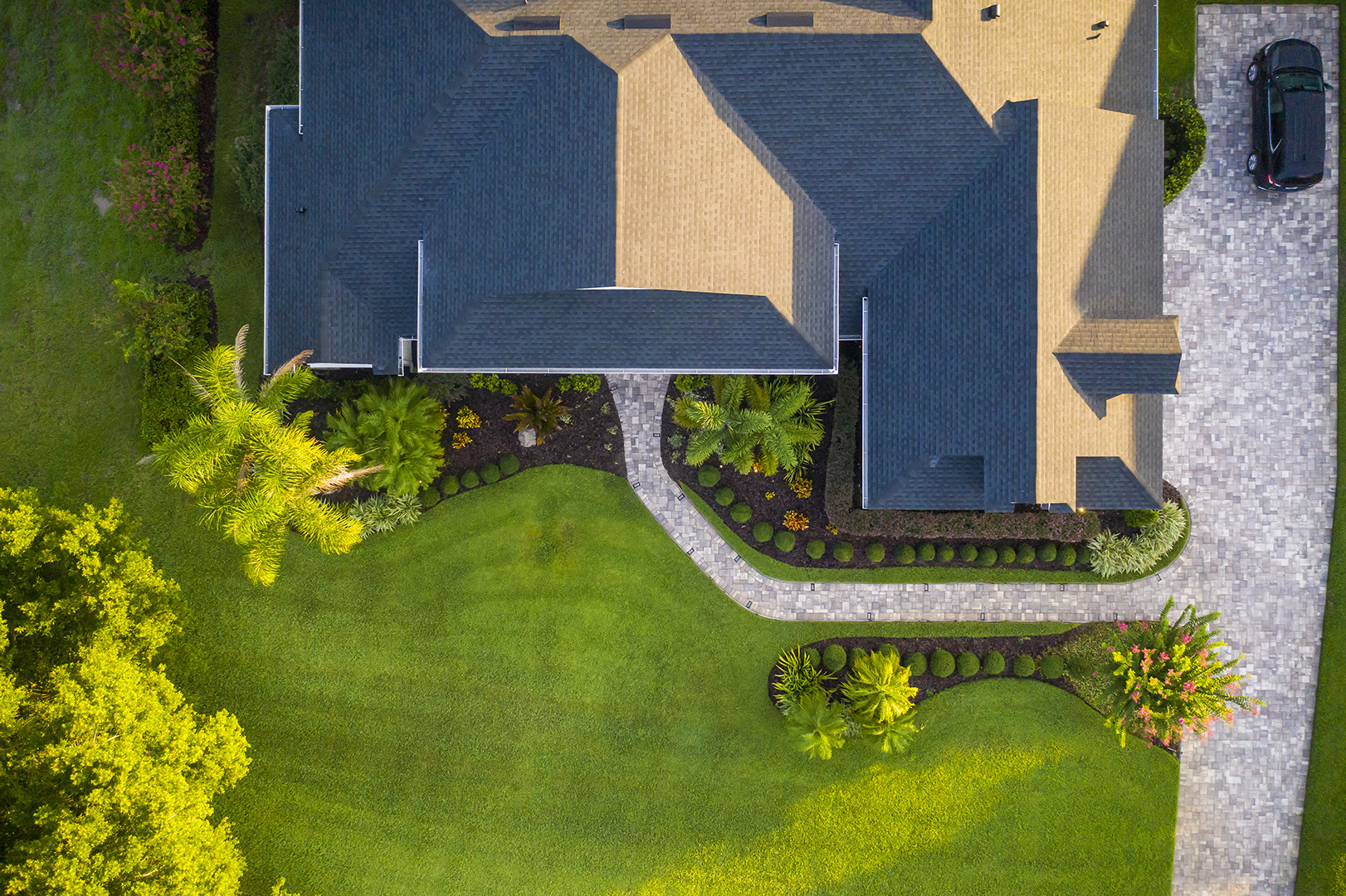 Aerial of paver pathway, driveway and plantings