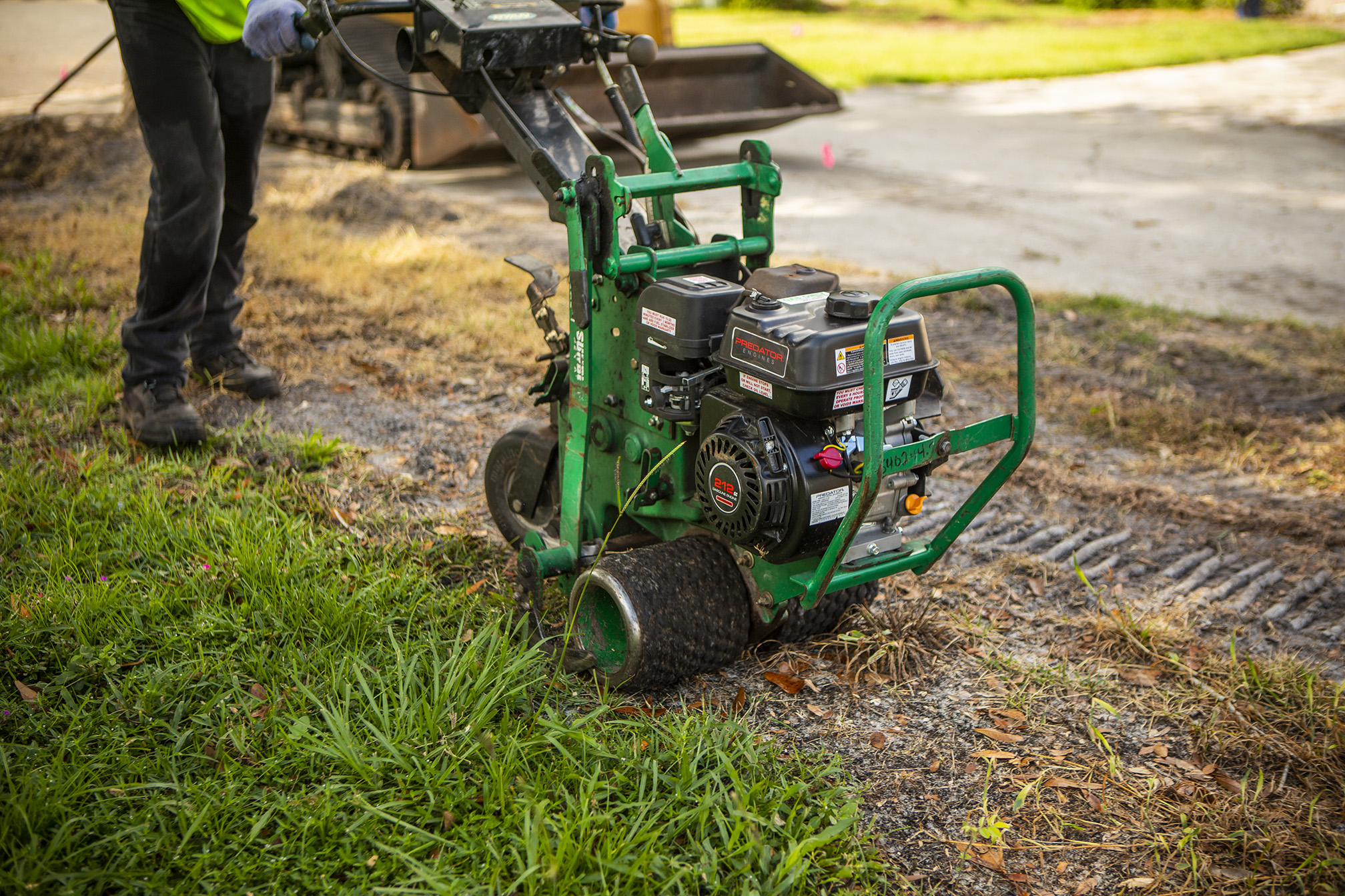 sod cutter being used to remove sod before new sod installation
