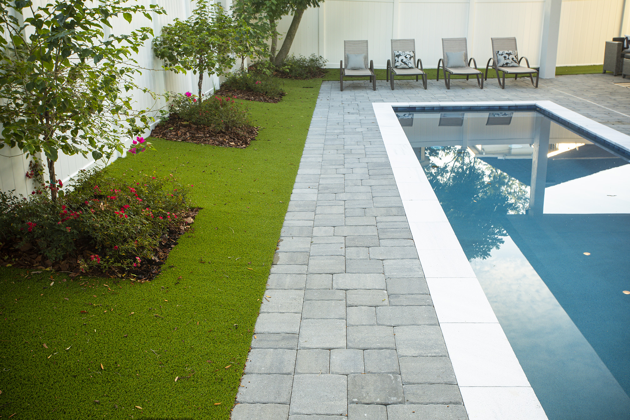 Mulching landscaping beds around a pool