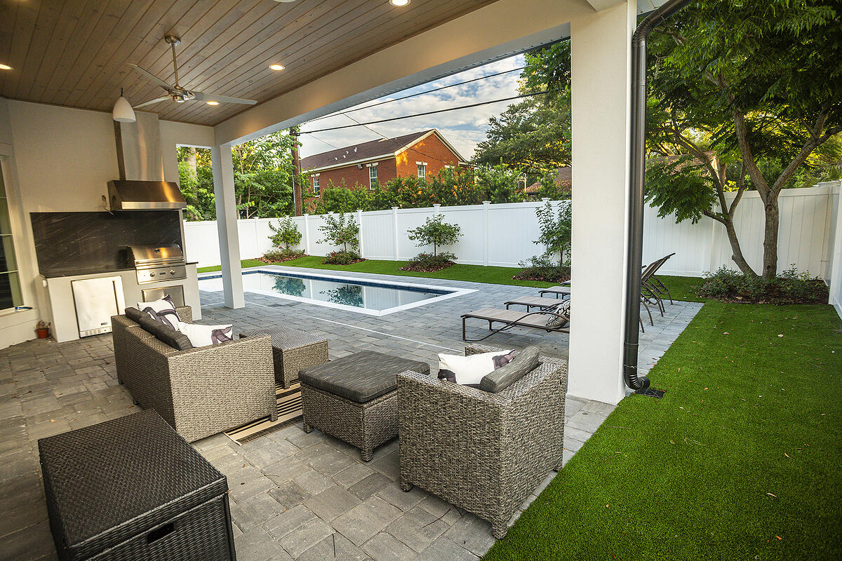 artificial grass around pool and patio