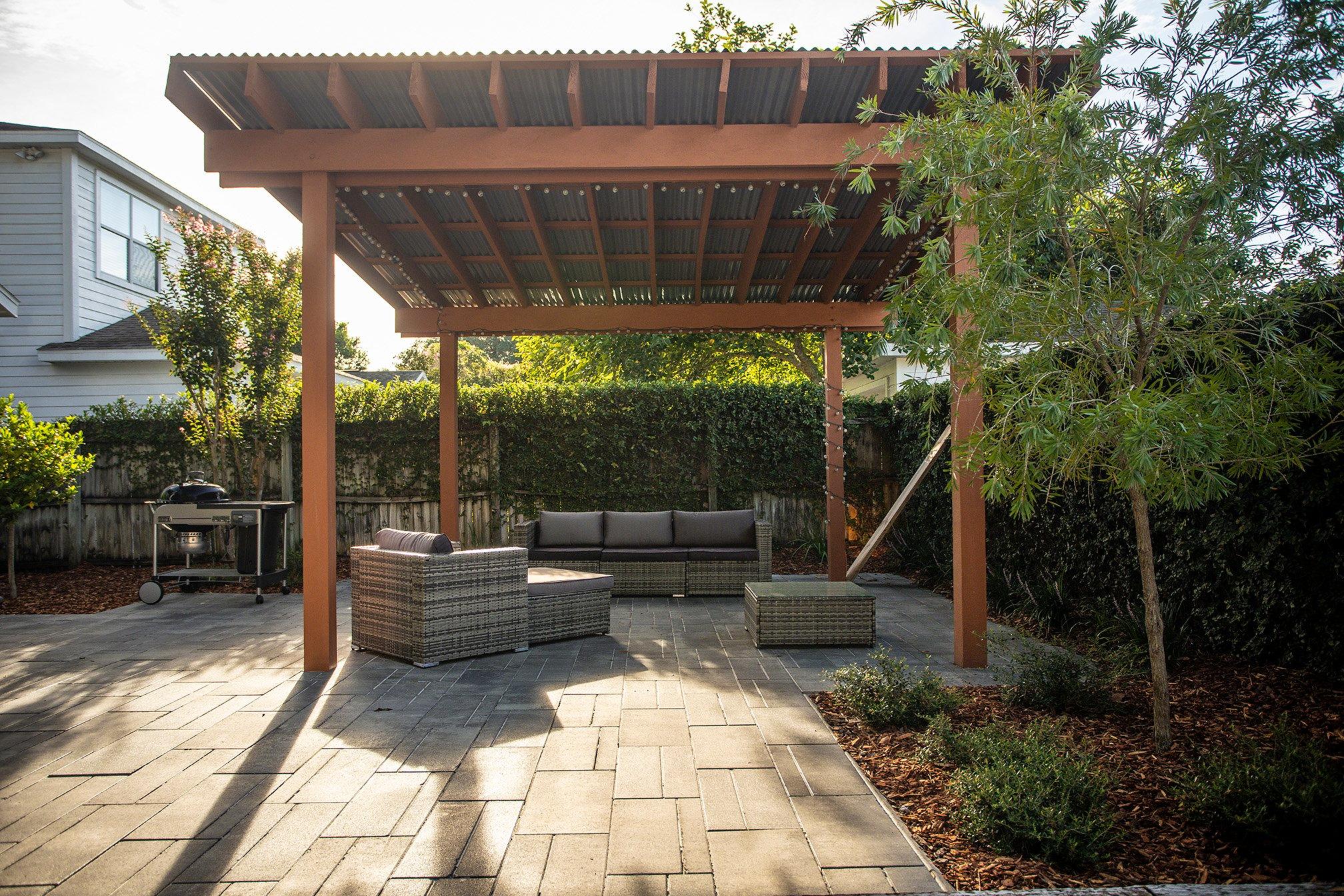 Paver patio with a pergola
