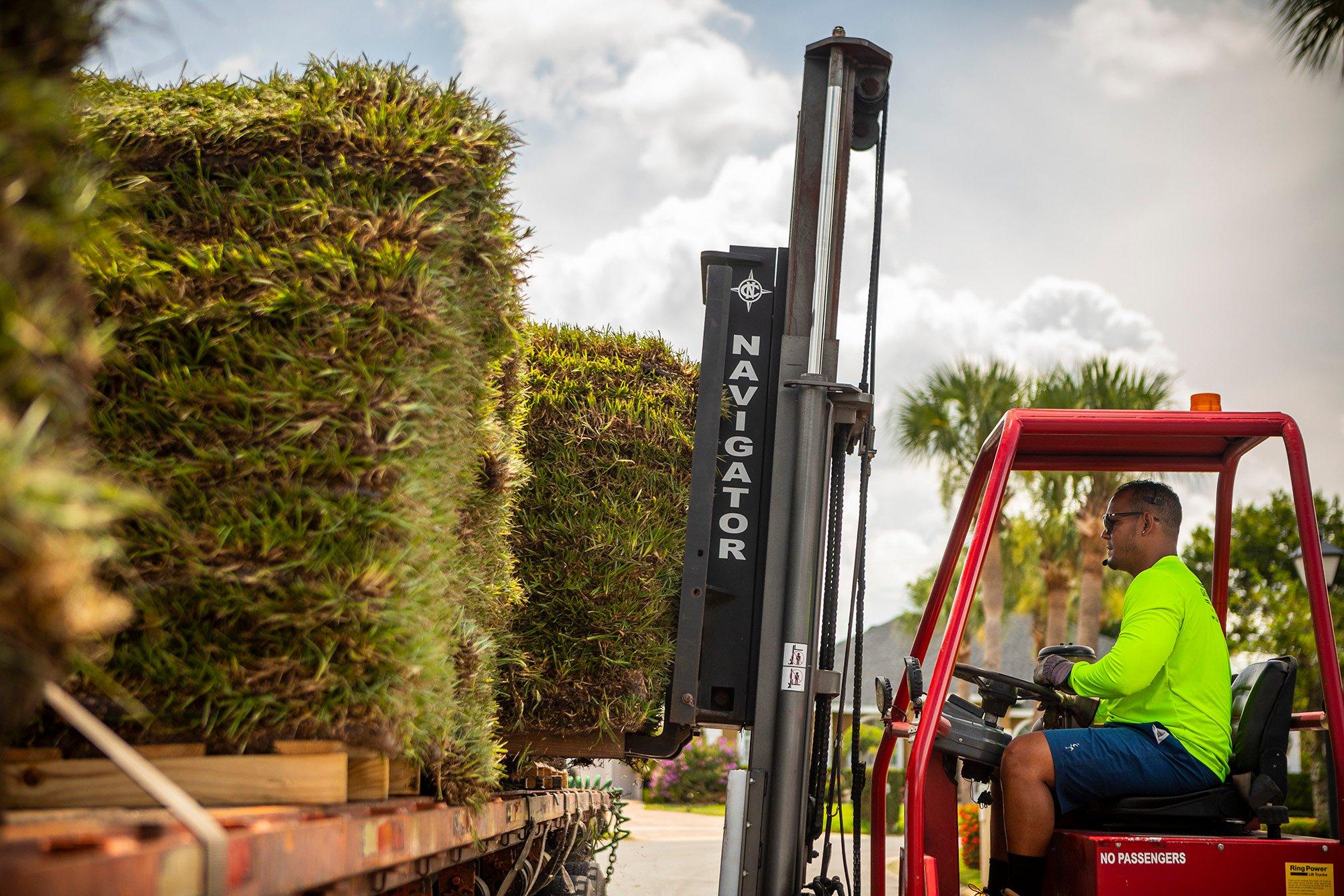 Landscape team unloading fresh sod
