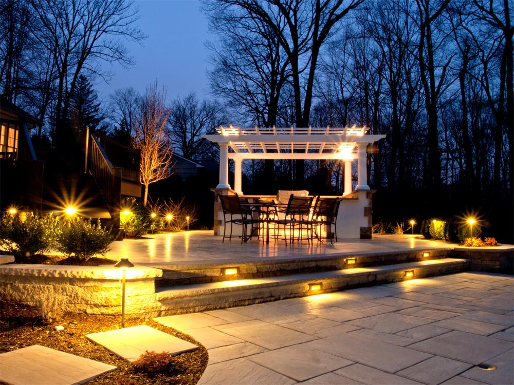 Landscape lighting for a paver patio, steps and plants