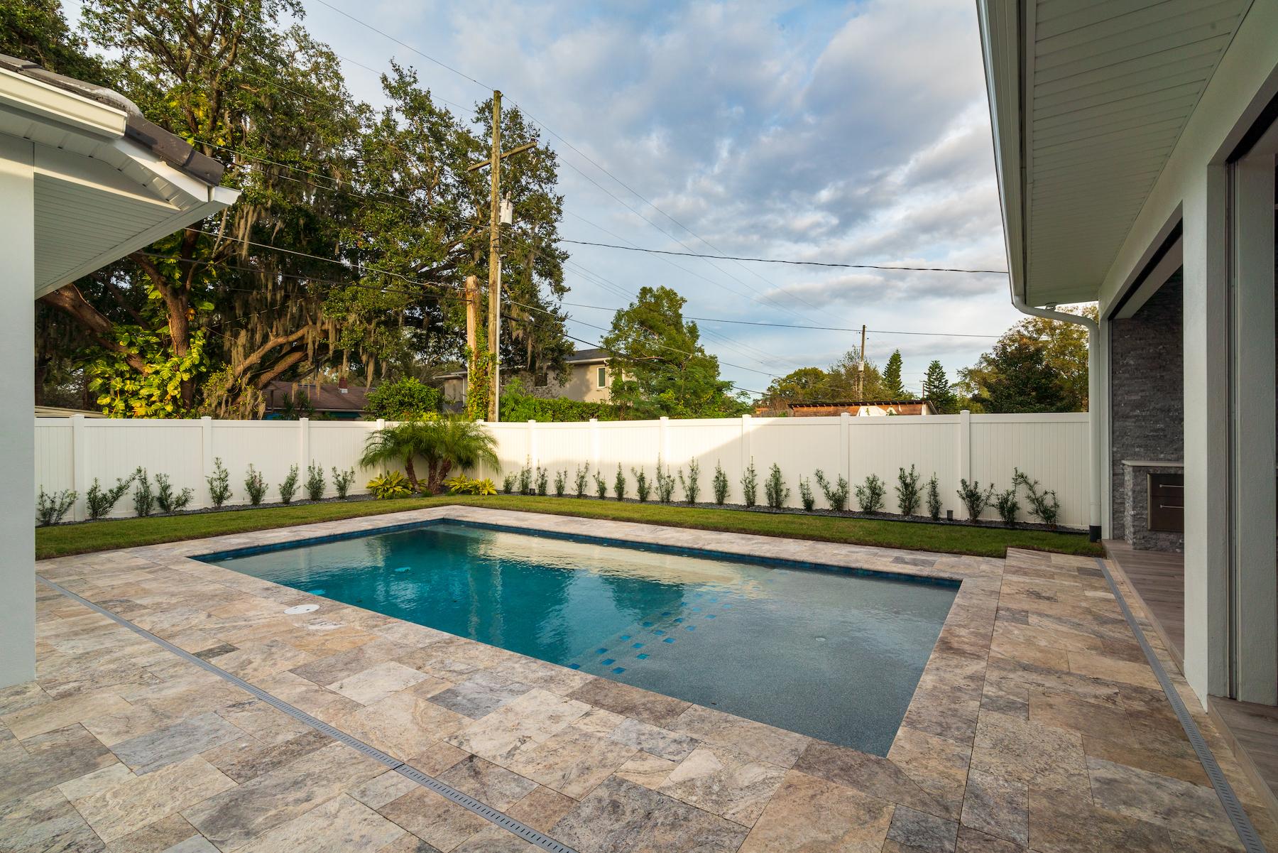 Paver patio around a pool