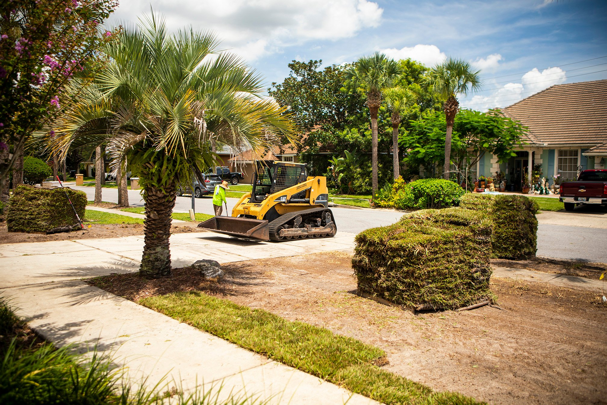 team skid steer sod installation